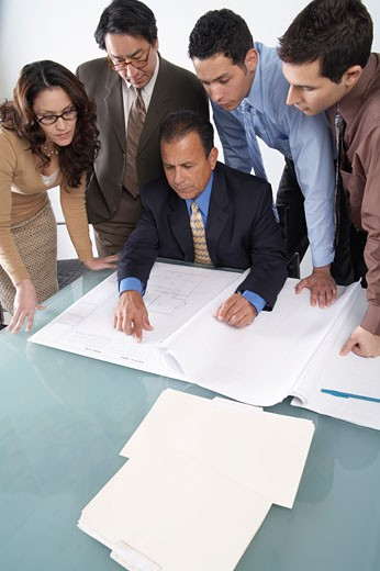 Stock Photo: 1828R-23100 Business People Looking at Blueprints