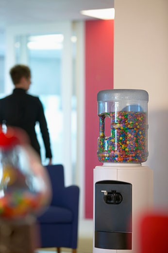 Stock Photo: 1828R-23195 Water Cooler Filled with Candy in Office