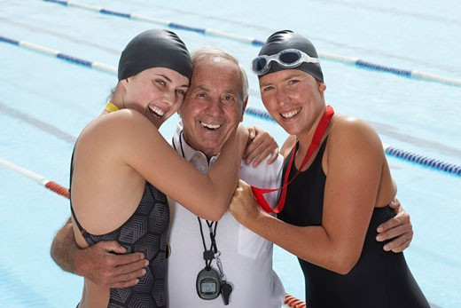 Stock Photo: 1828R-23564 Swimmers With Coach