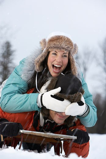 Portrait of Couple on Sled    : Stock Photo