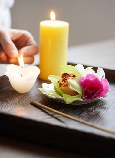 Stock Photo: 1828R-23952 Hand Lighting Candle