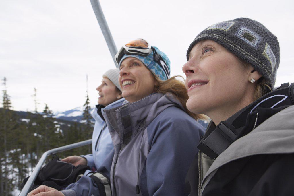 Stock Photo: 1828R-24268 Women on Ski Lift, Whistler, BC, Canada