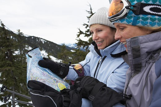 Stock Photo: 1828R-24270 Women Reading Trail Map, Whistler, BC, Canada
