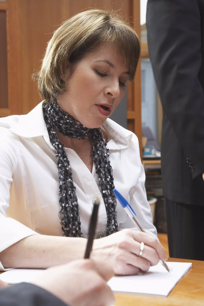 Stock Photo: 1828R-24439 Businesswoman Taking Notes