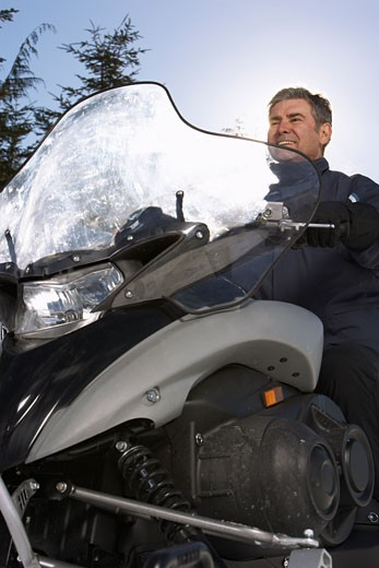 Stock Photo: 1828R-24476 Man on Snowmobile