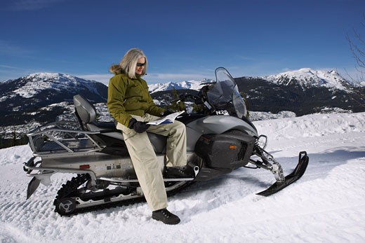 Stock Photo: 1828R-24484 Woman with Snowmobile