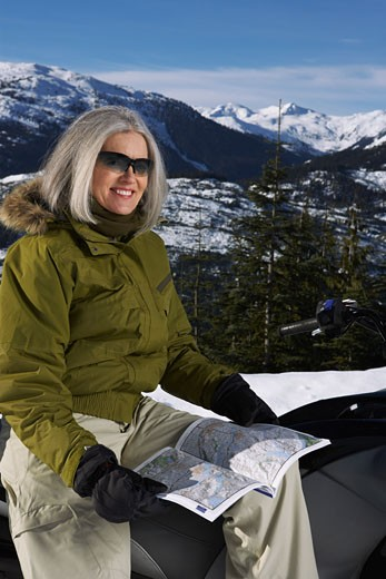 Woman with Snowmobile    : Stock Photo