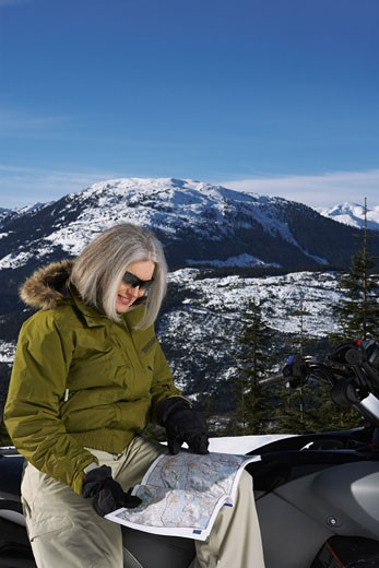 Stock Photo: 1828R-24486 Woman with Snowmobile