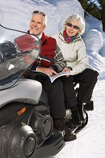 Stock Photo: 1828R-24489 Couple with Snowmobile