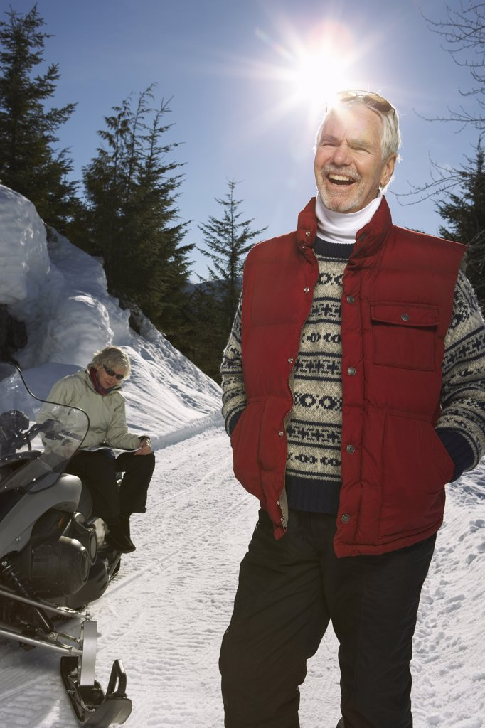Couple with Snowmobile    : Stock Photo