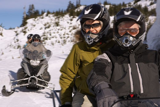 People Snowmobiling    : Stock Photo