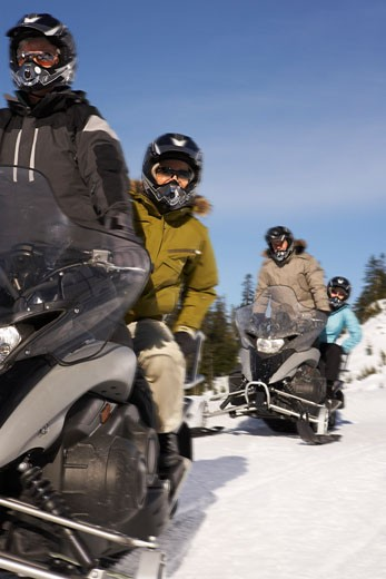 Stock Photo: 1828R-24498 People Snowmobiling