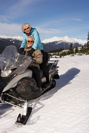 Stock Photo: 1828R-24502 Couple Snowmobiling
