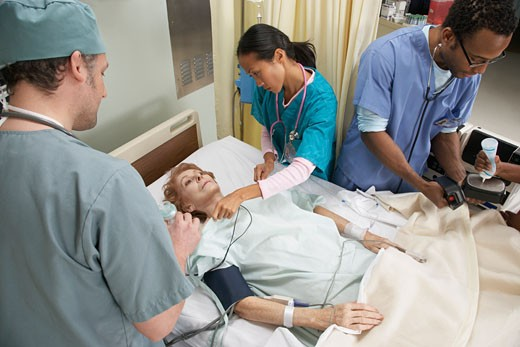 Stock Photo: 1828R-24661 Medical Team Treating Patient