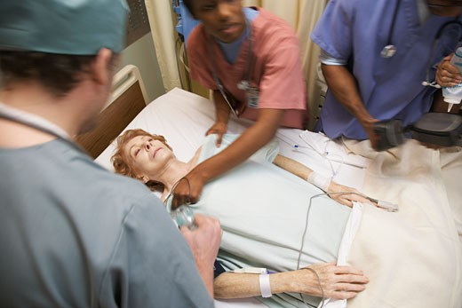 Stock Photo: 1828R-24664 Medical Team Treating Patient