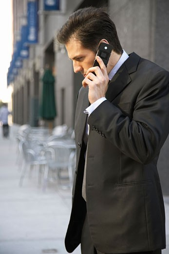 Stock Photo: 1828R-24747 Businessman Using Cell Phone