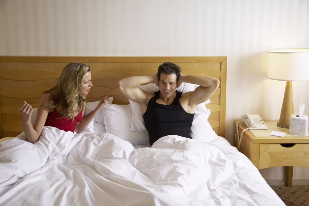 Stock Photo: 1828R-24758 Couple in Bed