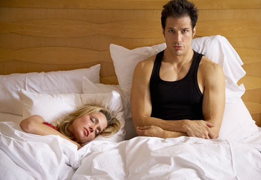 Stock Photo: 1828R-24761 Couple in Bed