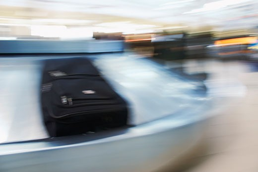 Stock Photo: 1828R-24860 Luggage on Baggage Carousel, Ottawa International Airport, Ottawa, Ontario, Canada