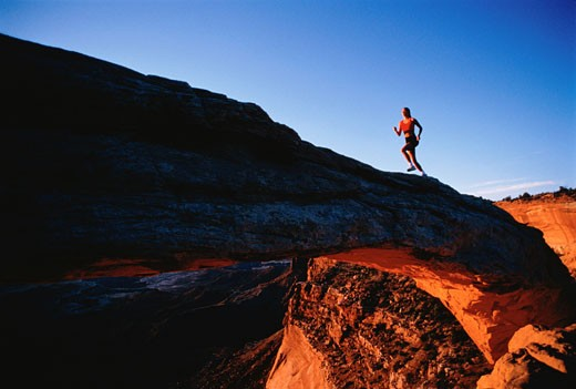 Woman Running Up Hill    : Stock Photo
