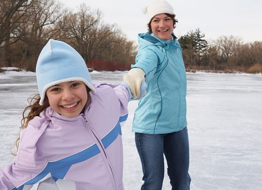 Mother and Daughter Skating    : Stock Photo
