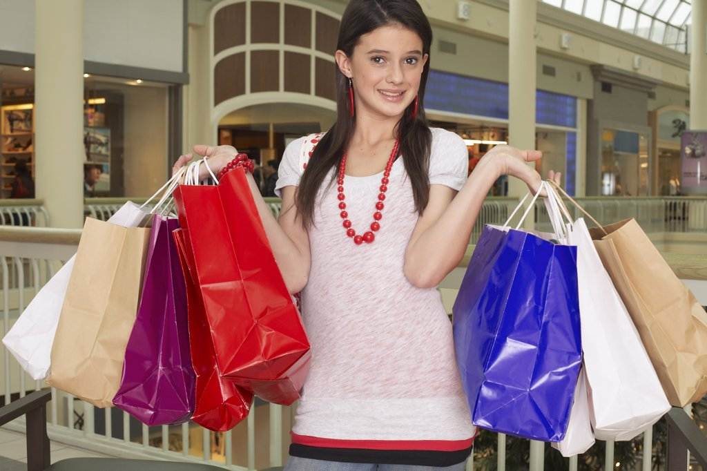 Stock Photo: 1828R-25809 Teenager with Shopping Bags