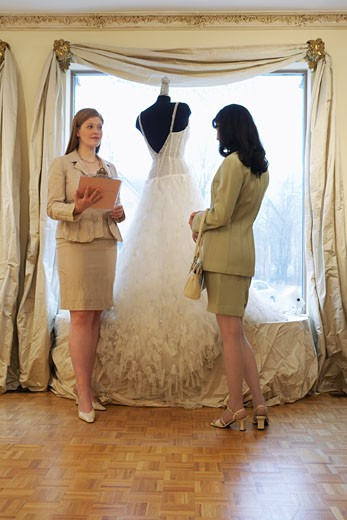 Saleswoman and Client in Bridal Boutique    : Stock Photo
