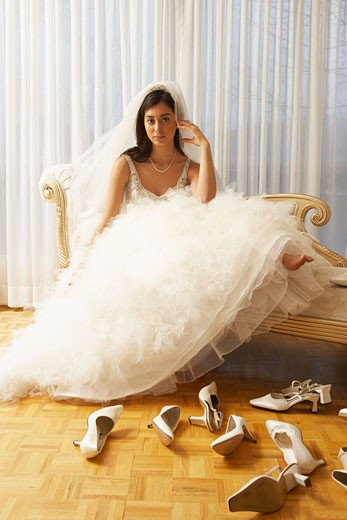 Stock Photo: 1828R-26126 Woman in Bridal Boutique Trying on Shoes