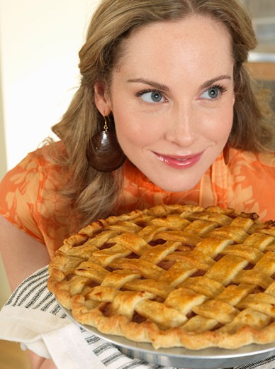 Portrait of Woman Smelling Pie    : Stock Photo