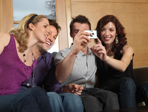 Group of People Using Digital Camera    : Stock Photo