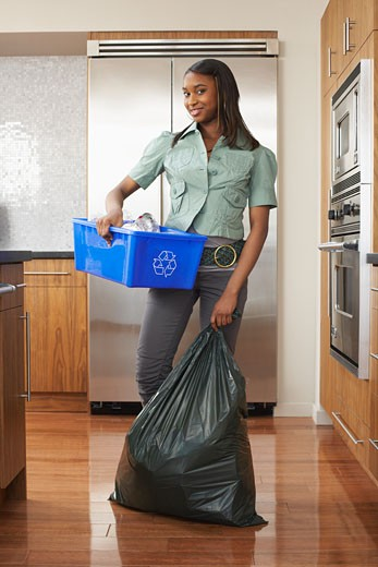 Stock Photo: 1828R-26404 Woman with Recycling Bin and Garbage Bag