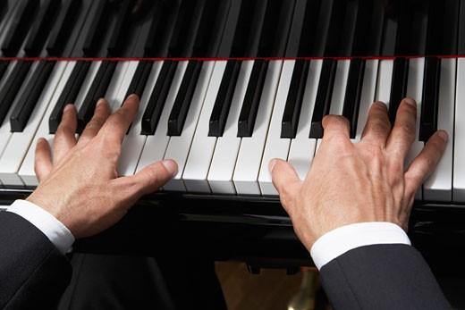Stock Photo: 1828R-26438 Man Playing Piano