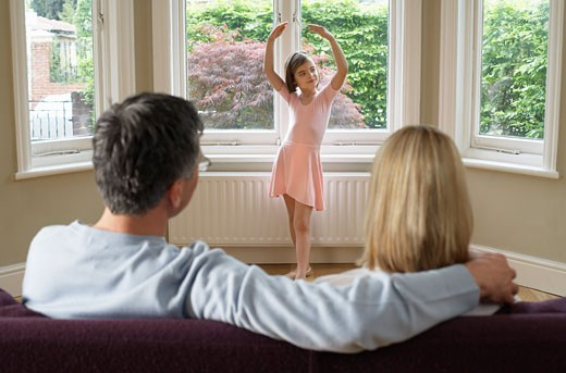 Stock Photo: 1828R-27035 Parents Watching Daughter Performing Ballet