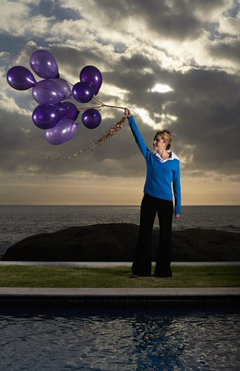 Stock Photo: 1828R-27156 Woman Holding Balloons