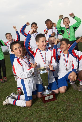 Stock Photo: 1828R-27391 Soccer Team With Gold Medals and Trophy