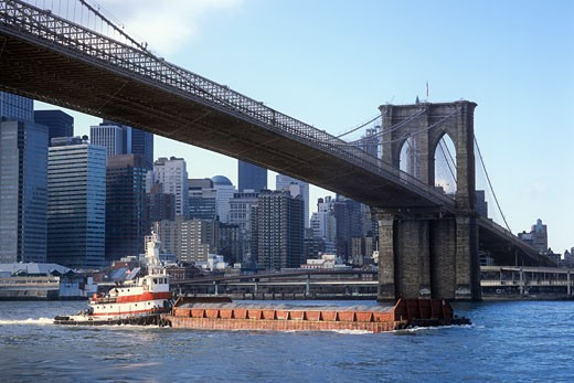 Stock Photo: 1828R-27456 Barge Passing Under Brooklyn Bridge, New York City, New York, USA