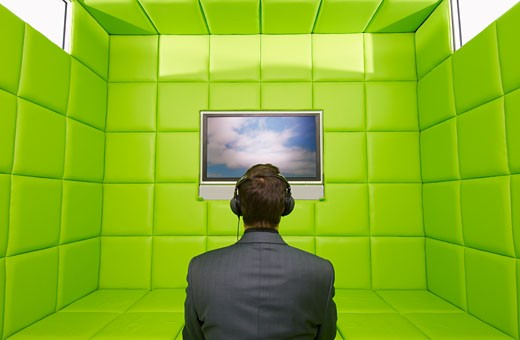 Stock Photo: 1828R-27570 Man Watching Television in Green Padded Room