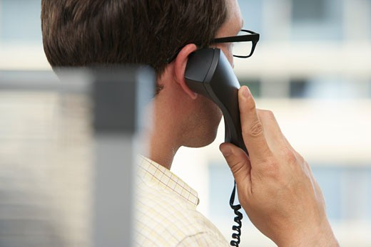 Businessman Using Telephone    : Stock Photo