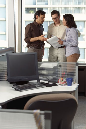 Stock Photo: 1828R-27611 Business People Having Discussion in Office