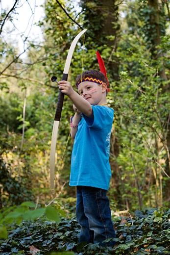 Stock Photo: 1828R-27687 Boy with Bow and Arrow