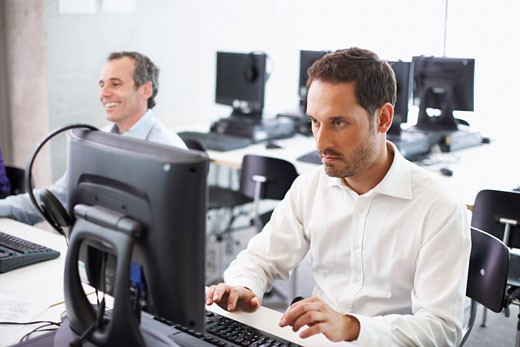 Stock Photo: 1828R-28185 Men Working on Computers in Office