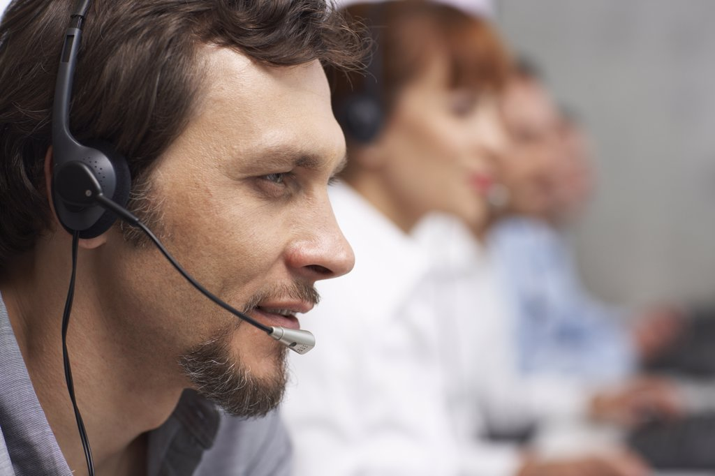 Stock Photo: 1828R-28189 Business People Working at Computers with Headsets
