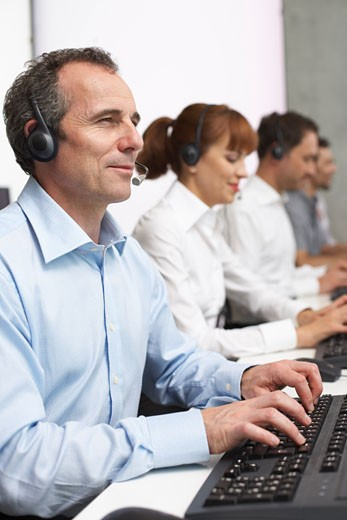 Stock Photo: 1828R-28200 Business People Working at Computers with Headsets