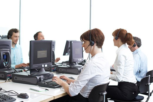Stock Photo: 1828R-28210 Business People Working on Computers with Headsets