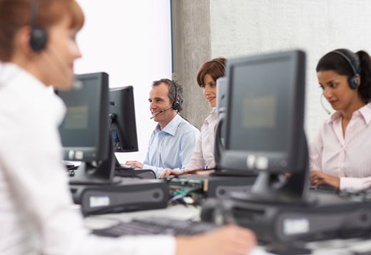 Business People Working on Computers with Headsets    : Stock Photo