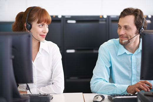 Stock Photo: 1828R-28227 Business People Working on Computers with Headsets