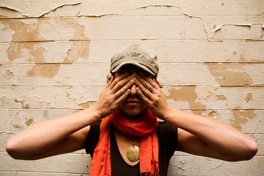 Stock Photo: 1828R-28315 Woman Covering Eyes with Hands