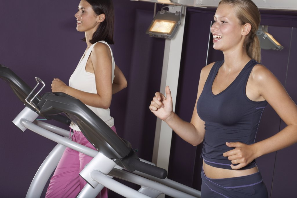 Stock Photo: 1828R-28375 Women Working Out on Treadmills