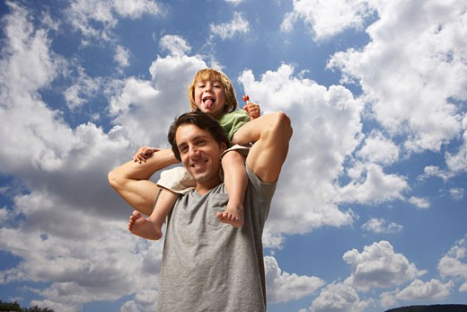 Stock Photo: 1828R-28668 Boy Riding on Father's Shoulders