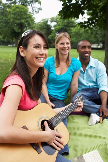 Friends Sitting Outdoors    : Stock Photo